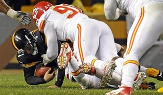 Pittsburgh Steelers quarterback Ben Roethlisberger (7) is sacked by Kansas City Chiefs outside linebacker Tamba Hali (91) in the third quarter of an NFL game, Monday, Nov. 12, 2012, in Pittsburgh. Roethlisberger left the game with a right shoulder injury. (AP Photo/Don Wright)