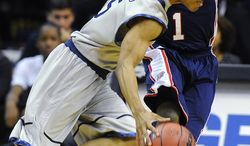 Duquesne's Derrick Colter (1) tries to defend against Georgetown's Markel Starks (5) during their NCAA college basketball game, Sunday, Nov. 11, 2012, in Washington. Georgetown won 61-55. (AP Photo/Richard Lipski)