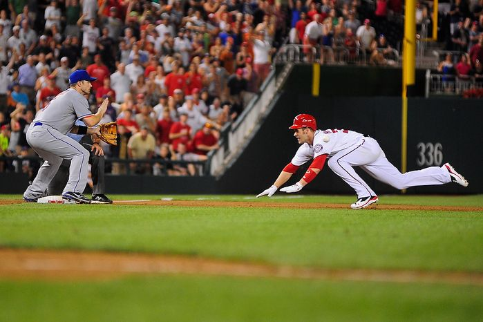 Bryce Harper slides in to third base in the bottom of the tenth inning during the Washington Nationals game against the New York Mets at Nationals Park, Washington D.C.,Tuesday, July 17, 2012.   Harper's triple allowed Jhonatan Solano to score tying  the game at 4-4.  (Ryan M.L. Young/The Washington Times)