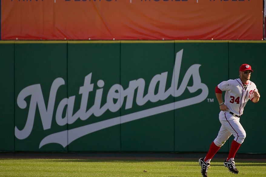 Washington Nationals right fielder Bryce Harper (34) runs sprints in the outfield following a game between the Washington Nationals and the Houston Astros during spring training at Space Coast Stadium, Viera, Fla., Sunday, March 4, 2012. The Nationals lost to the Asros 10-2. (Andrew Harnik/The Washington Times)