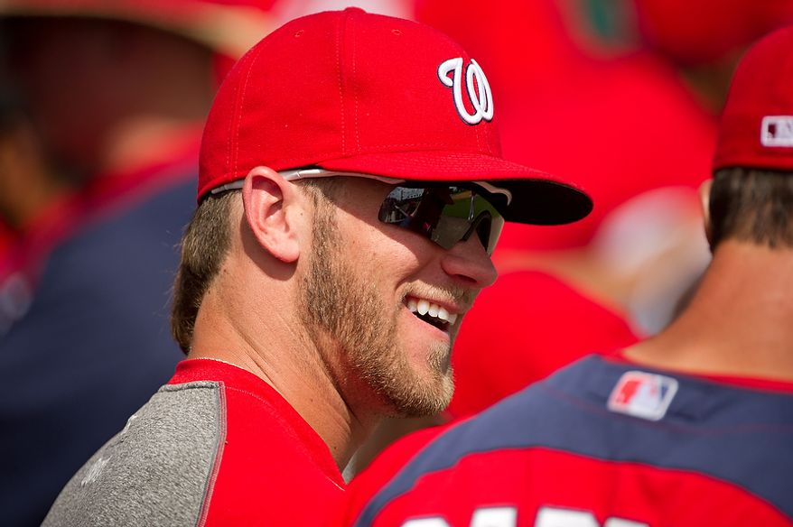 Washington Nationals right fielder Bryce Harper (34) shares a laugh with a teammate as the Washington Nationals plays the Georgetown Hoyas during spring training exhibition game at Space Coast Stadium, Viera, Fla., Friday, March 2, 2012. (Andrew Harnik/The Washington Times)