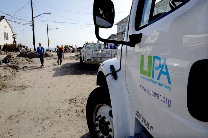 A Long Island Power Authority (LIPA) truck is seen in the Belle Harbor neighborhood of the borough of Queens, New York, Monday, Nov. 12, 2012, in the wake of Superstorm Sandy. More than 70,000 customers of Long Island Power Authority in New York were without electricity Monday, two weeks after Superstorm Sandy struck. (AP Photo/Craig Ruttle)