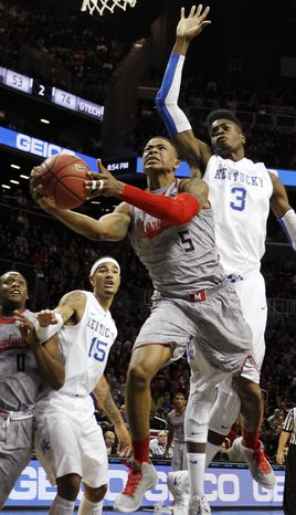 Maryland's Nick Faust (5) shoots against Kentucky's Nerlens Noel (3) during the first half of their NCAA college basketball game in the Barclays Center Classic, Friday, Nov. 9, 2012, in New York. (AP Photo/Jason Decrow)