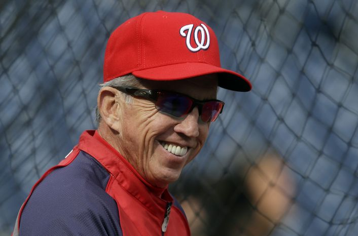 FILE - In this Oct. 10, 2012, file photo, Washington Nationals manager Davey Johnson watches his players take batting practice before Game 3 of the National League division baseball series against the St. Louis Cardinals in Washington. The Nationals are bringing back Johnson for one more season as their manager.  Johns