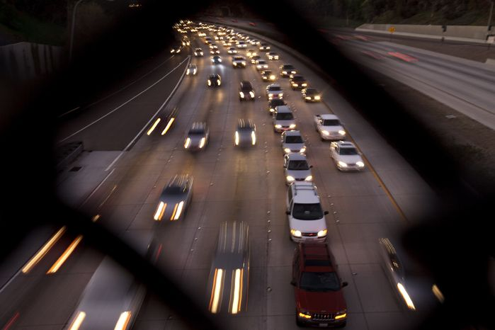 **FILE** Cars fill a San Diego highway on Nov. 22, 2011, two days before Thanksgiving. (Associated Press)