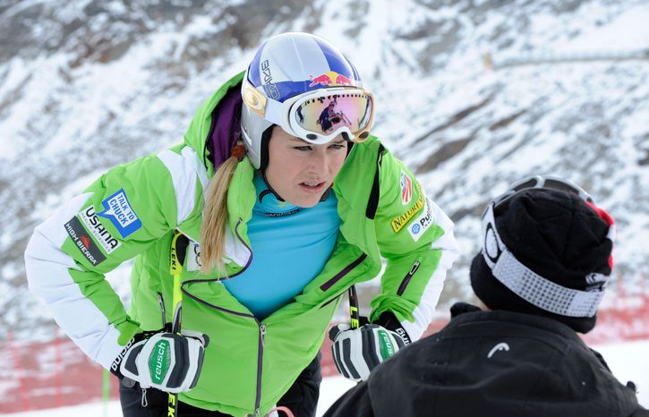 """FILE - In this Friday, Oct. 26, 2012 file photo, Lindsey Vonn, of the United States, left, speaks with a trainer during a course inspection on the glacier of Soelden, in Austria. Vonn's request to compete in a men's World Cup downhill race has been rejected by the International Ski Federation. The FIS council met Saturday, Nov. 3, 2012, in Oberhofen, Switzerland, and """"confirmed that one gender is not entitled to participate in races of the other,"""" adding in a statement that """"exceptions will not be made to the FIS Rules."""" (AP Photo/Giovanni Auletta, File)"""
