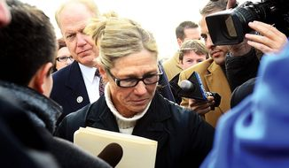 Rita Crundwell, the former comptroller of Dixon, Ill., pleaded guilty to a charge of wire fraud in federal court Wednesday. Crundwell embezzled more than $50 million from her small town to bankroll a lavish lifestyle that included a nationally known horse-breeding operation. Her sentencing hearing is Feb. 14. (Associated Press)