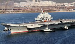 **FILE** China's only aircraft carrier, Liaoning, returns to port Oct. 30 after its first navy sea trial, in Dalian in northeastern China's Liaoning province. (Associated Press)