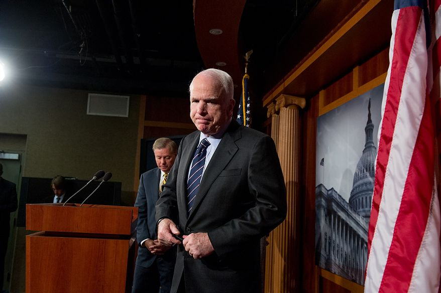 Sens. John McCain (R-Ariz.), right, Lindsey Graham (R-S.C.), left, leave after holding a press conference at the U.S. Capitol Building calling for a Senate Armed Services Committee Hearing on the Benghazi attack, Washington, D.C., Wednesday, November 14, 2012. (Andrew Harnik/The Washington Times)