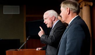 Sens. John McCain (R-Ariz.), center, and Lindsey Graham (R-S.C.), right, hold a press conference at the U.S. Capitol Building calling for a Senate Armed Services Committee Hearing on the Benghazi attack, Washington, D.C., Wednesday, November 14, 2012. (Andrew Harnik/The Washington Times)