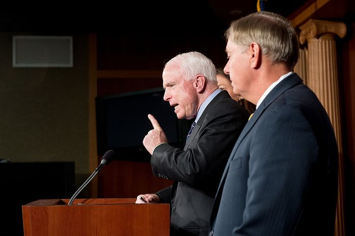 Sens. John McCain (R-Ariz.), center, and Lindsey Graham (R-S.C.), right, hold a press conference at the U.S. Capitol Building calling for a Senate Armed Services Committee Hearing on the Benghazi attack,