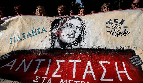 "Protesters carry a banner reading ""Resist the measures"" during a union protest outside Parliament in Athens on Nov. 14, 2012. Workers across the European Union sought to present a united front against rampant unemployment and government spending cuts with a string of strikes and demonstrations across the region. (Associated Press)"