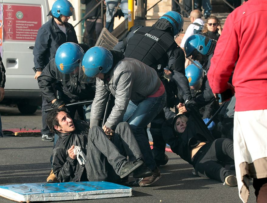 Demonstrators clash with riot police during a protest against Italian Government austerity measures in Rome, Wednesday, Nov. 14, 2012. Workers across the European Union sought to present a united front against rampant unemployment and government spending cuts Wednesday with a string of strikes and demonstrations across the region. Protesters clashed with police in various demonstrations in Rome, Milan, Turin, Padua and Brescia. (AP Photo/Gregorio Borgia)