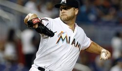 ** FILE ** In this May 26, 2012 photo, Miami Marlins starting pitcher Mark Buehrle throws in the first inning of a baseball game against the San Francisco Giants in Miami. A person familiar with the deal told The Associated Press on condition of anonymity Tuesday, Nov. 13, that the Marlins have traded Buehrle to the Toronto Blue Jays. (AP Photo/Lynne Sladky)