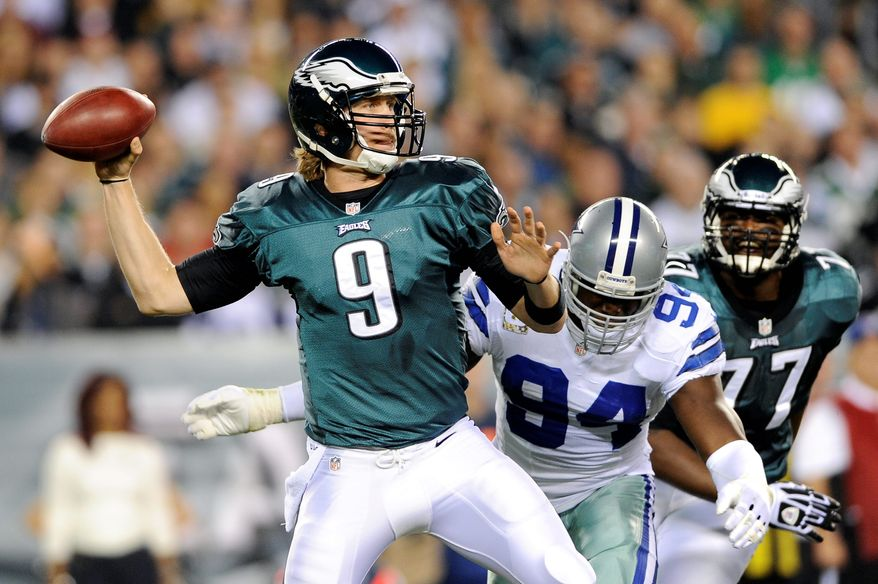 Philadelphia Eagles quarterback Nick Foles, left, passes as Dallas Cowboys outside linebacker DeMarcus Ware pressures in the first half of an NFL football game, Sunday, Nov. 11, 2012, in Philadelphia. (AP Photo/Michael Perez)