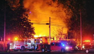 Flames and smoke billow from a home in west Jackson, Miss., Tuesday evening, Nov. 13, 2012, after authorities say a small plane carrying three people crashed into the residence shortly after 5 p.m. (AP Photo/The Clarion-Ledger, Joe Ellis)