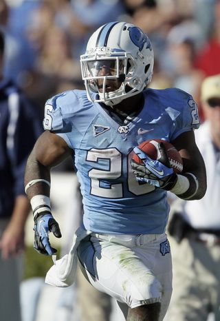 North Carolina's Giovani Bernard (26) runs the ball against Georgia Tech during the second half of an NCAA college football game in Chapel Hill, N.C., Saturday, Nov. 10, 2012. Georgia Tech won 68-50. (AP Photo/Gerry Broome)
