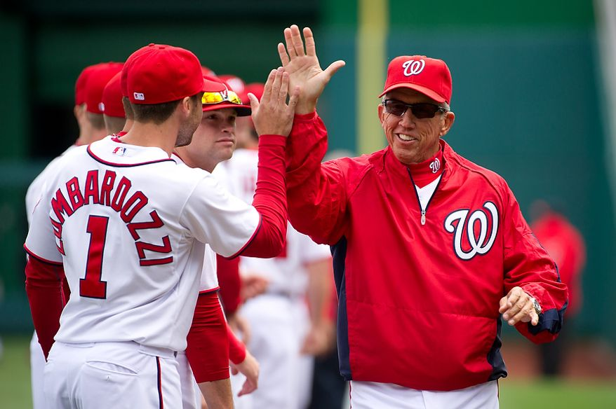 **FILE** Washington Nationals second baseman Stephen Lombardozzi (1) high-fives Washington Nationals manager Davey Johnson before the Nationals' 2012 home opener against the Cincinnati Reds at Nationals Park in Washington on April 12, 2012. (Andrew Harnik/The Washington Times)