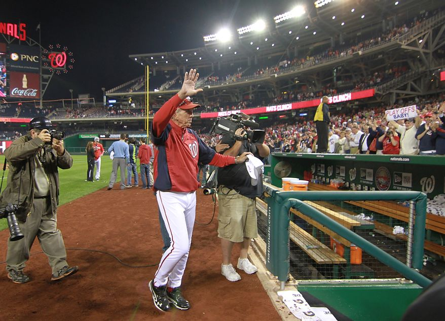 **FILE** Washington Nationals manager Davey Johnson celebrates Sept. 20, 2012, after beating the Los Angeles Dodgers, 4-1, at Nationals Park in Washington. The Nationals clinched a postseason bid with the win. (Craig Bisacre/The Washington Times)