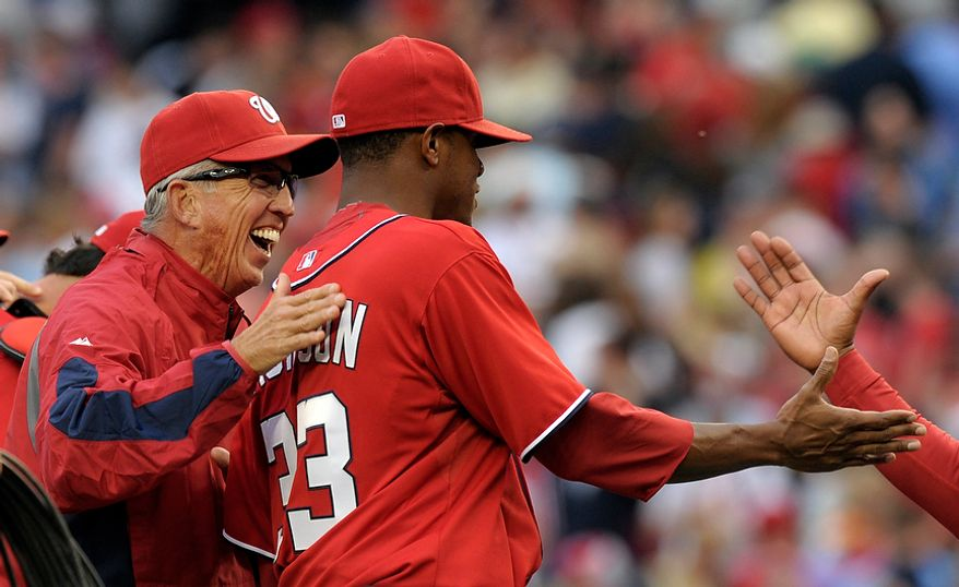 Washington Nationals manager Davey Johnson (left) congratulates pitcher Edwin Jackson on April 14, 2012, after the Nationals' home victory over the Cincinnati Reds, 4-1. (Associated Press)