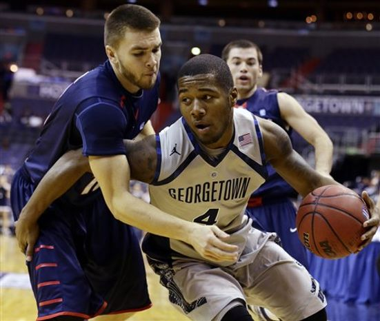 Liberty guard Larry Taylor, left, guards Georgetown guard D'Vauntes Smith-Rivera during the second half of an NCAA basketball game on Wednesday, Nov. 14, 2012, in Washington. Georgetown won 68-59. (AP Photo/Alex Brandon)