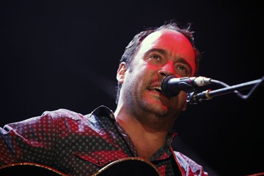 ** FILE ** This Sept. 22, 2012, file photo shows Dave Matthews of the Dave Matthews Band performing during the Farm Aid 2012 concert at Hersheypark Stadium in Hershey, Pa. The band is giving $1 million to help Superstorm Sandy recovery efforts in New Jersey and New York. (AP Photo/Jacqueline Larma, file)
