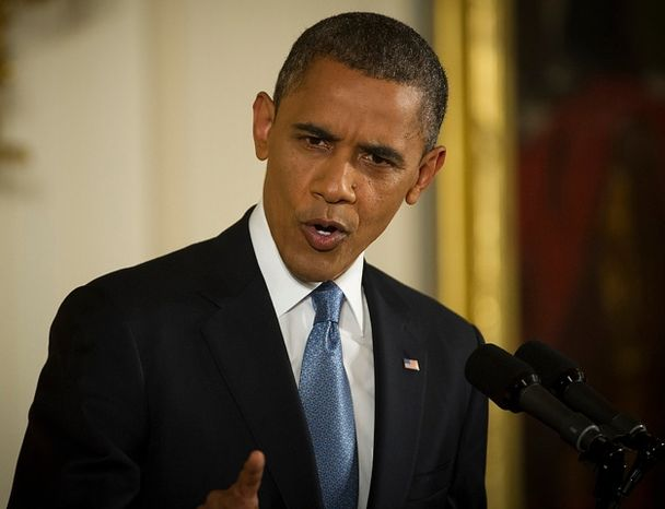 President Barack Obama focuses his gaze on a reporter as he responds to question regarding the criticism of UN Ambassador Susan Rice and the Benghazi, Libya attacks, during a press conference in the East Room at The White House in Washington, D.C., Wednesday, Nov. 14, 2012. (Rod La