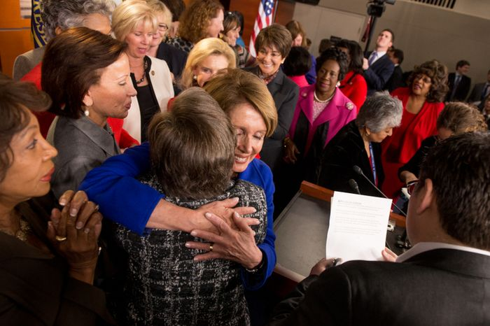 House Minority Leader Nancy Pelosi, California Democrat, is congratulated by House congresswomen, as she announces that she will stay on at that post at the U.S. Capitol Building, Washington, D.C., Wednesday, Nov. 14, 2012. (Andrew Harnik/The Washington Times)