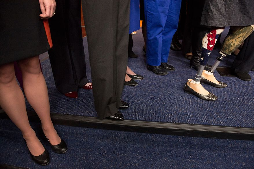 House congresswomen, including Rep. Tammy Duckworth (D-Illinois), right, who lost both her legs and part of one arm while serving in Iraq,  stand together as House Minority Leader Nancy Pelosi (D-Calif.) announces that she will stay on as House minority leader at the U.S. Capitol Building, Washington, D.C., Wednesday, November 14, 2012. (Andrew Harnik/The Washington Times)