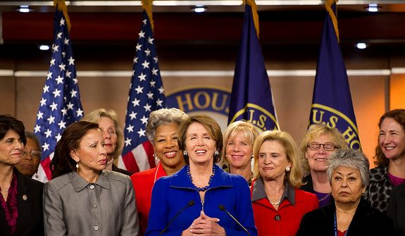 House Minority Leader Nancy Pelosi (D-Calif.), center, surrounded by House congresswomen, announces that she will stay on as House minority leader at the U.S. Capitol Building, Washington, D.C., Wednesday, November 14, 2012. (Andrew Harnik/The Washington Times)