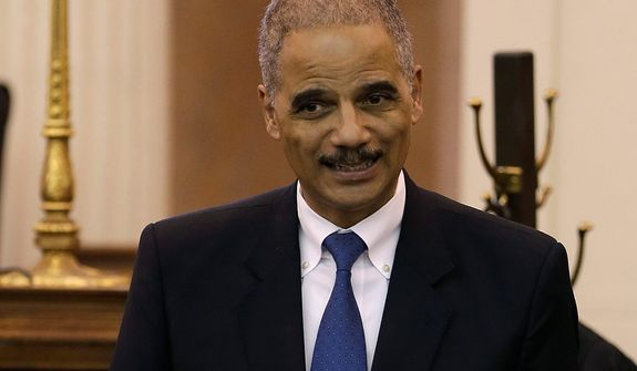 Attorney General Eric Holder speaks Nov. 13, 2012, in Des Moines, Iowa, during the investiture of Stephanie Rose, U.S. District Judge for the Southern District of Iowa. (Associated Press)