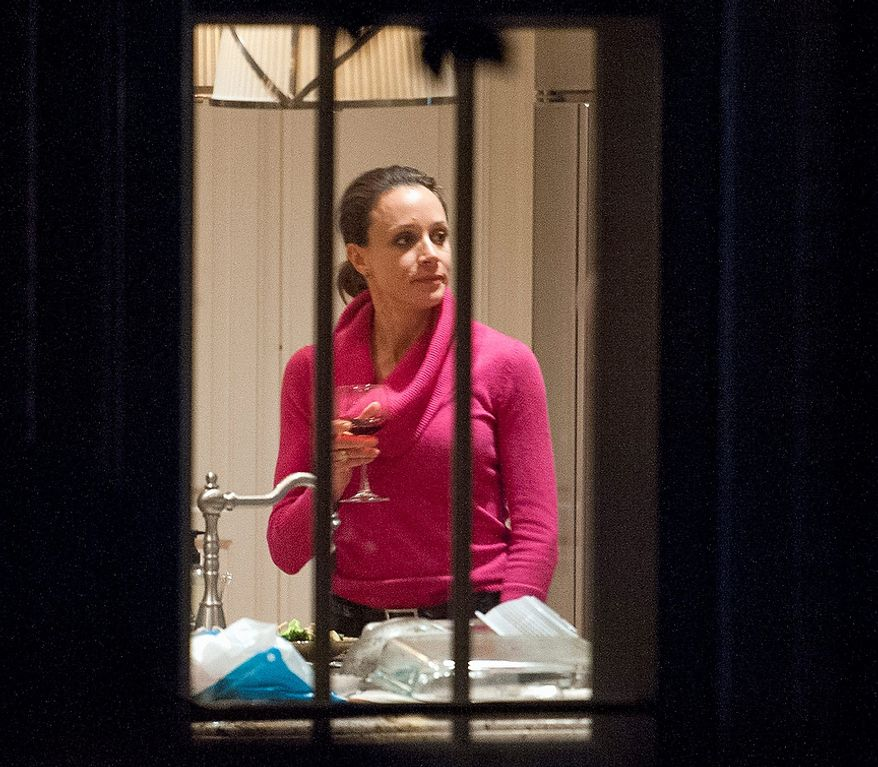 Paula Broadwell holds a drink in the kitchen of her brother's house in Washington, Tuesday, Nov. 13, 2012. Broadwell is CIA Director David Petraeus' biographer, with whom he had an affair that led to his abrupt resignation last Friday. It was Broadwell's threatening emails to Jill Kelley, a Florida woman who is a Petraeus family friend, that led to the FBI's discovery of communications between Broadwell and Petraeus indicating they were having an affair. (AP Photo/Cliff Owen)