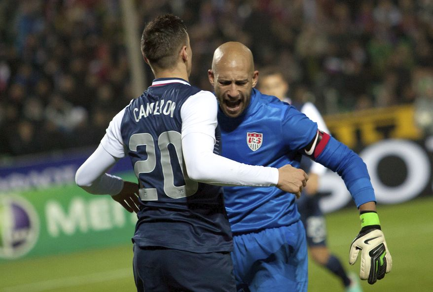 Geoff Cameron, left, and goalkeeper Tim Howard, both of the United States, react after a successful defense attempt during the friendly soccer match between Russia and United States, in Krasnodar, Russia, on Wednesday, Nov. 14, 2012. The match ended a 2-2 draw. (AP Photo/Ignat Kozlov)