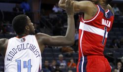 Washington Wizards' Trevor Ariza (1) shoots over Charlotte Bobcats' Michael Kidd-Gilchrist (14) during the second half of an NBA basketball game in Charlotte, N.C., Tuesday, Nov. 13, 2012. Charlotte won 92-76. (AP Photo/Chuck Burton)