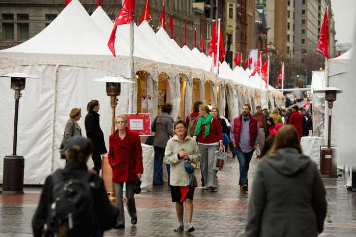 Shoppers make their way through the rain at the annual Downtown Holiday Market in front of the Portrait Gallery in Chinatown which is open until December 23rd, Washington, DC, Wednesday, December 21, 2011. (Andrew Harnik / The Washington Times)