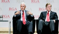 Indiana Gov.-Elect Mike Pence, left, and Republican Governors Association Chairman Virginia Gov. Bob McDonnell participate in a panel discussion during the 2012 RGA Annual Conference at Encore hotel-casino Thursday, Nov. 15, 2012, in Las Vegas. (AP Photo/Ronda Churchill)