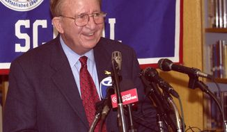 Morgan Wootten, former head basketball coach at DeMatha High School smiles at a press conference to announce his stepping down as coach, Wednesday, Nov. 6, 2002, in Hyattsville, Md. Wootten's career record is 1,274-192. (AP Photo/Nick Wass)