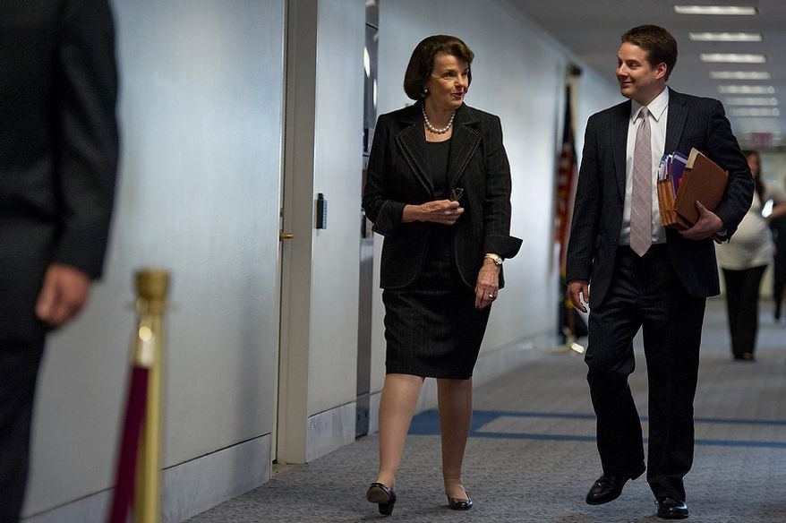Chairman Dianne Feinstein (D-Calif) of the Senate Select Committee on Intelligence, center, arrives for a closed door Senate Select Committee on Intelligence hearing to discuss the September 11, 2012 attack on the U.S. Consulate in Benghazi, Libya, and the intelligence and security situation in other Arab Spring countries at the Hart Senate Office Building, Washington, D.C., Thursday, November 15, 2012. (Andrew Harnik/The Washington Times)