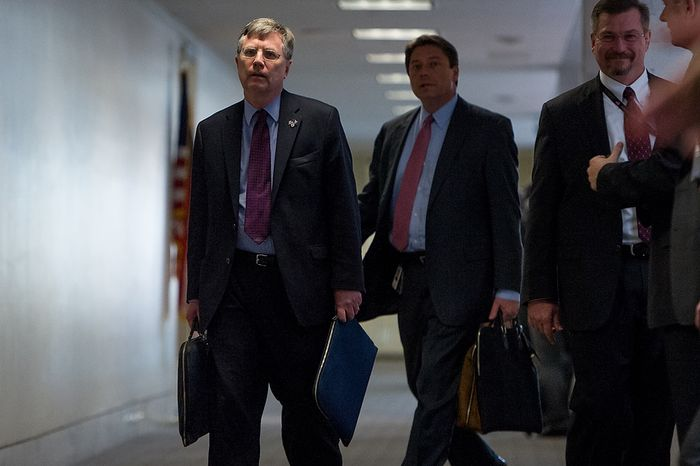 Under Secretary of State for Management Pat Kennedy, left, arrives for a closed door Senate Select Committee on Intelligence hearing to discuss the September 11, 2012 attack on the U.S. Consulate in Benghazi, Libya, and the intelligence and security situation in other Arab Spring countries at the Hart Senate Office Building, Washington, D.C., Thursday, November 15, 2012. (Andrew Harnik/The Washington Times)