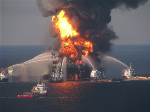 ** FILE ** In this April 21, 2010, file image provided by the U.S. Coast Guard, fire boat response crews battle the blazing remnants of the off shore oil rig Deepwater Horizon. (AP Photo/U.S. Coast Guard, File)