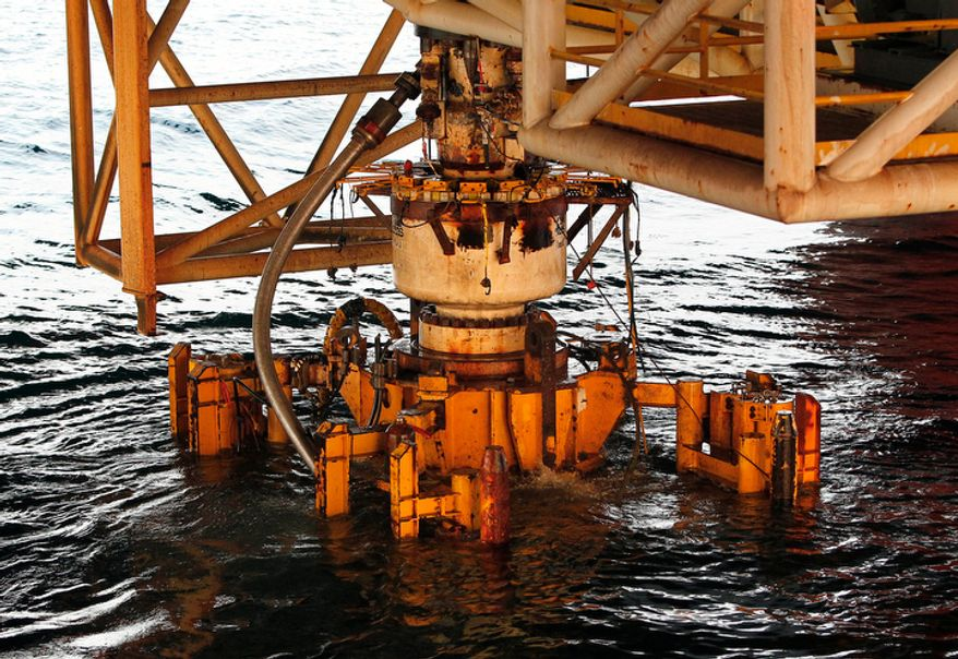 In this Sept. 4, 2010 file photo, the Deepwater Horizon blowout preventer is lifted out of the Gulf of Mexico by the Helix Q4000 near the coast of Louisiana. Before the key piece of evidence has even been analyzed, oil giant BP PLC on Wednesday, Sept. 8, 2010, planned to release the conclusions of its internal investigation into the rig explosion that killed 11 workers and led to the massive Gulf of Mexico spill. (AP Photo/Patrick Semansky, File)