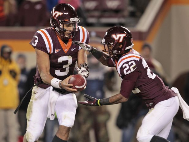 Virginia Tech quarterback Logan Thomas (3) hands the ball off to Virginia Tech running back Tony Gregory (22) during the second half of a NCAA college football game in Blacksburg, Va., Thursday, Nov. 8, 2012. Florida State won the game 22-28. (AP Photo/Steve Helber)