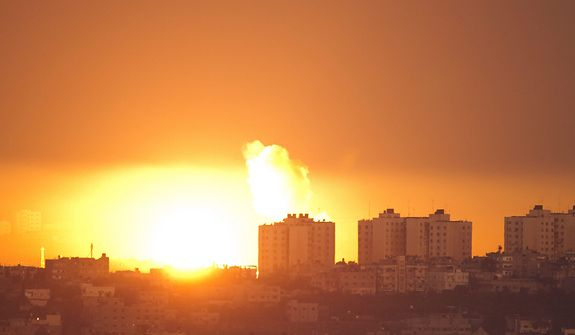 Explosion and smoke rises following an Israeli air strike in the northern Gaza Strip, seen from southern Israel near the Israel-Gaza border on Nov. 15, 2012. (Associated Press)