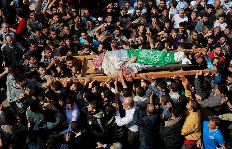 Palestinian mourners carry the body of Hamas' top military commander Ahmed Jabari, who was killed in an Israeli strike the previous day, during his funeral in Gaza City on Nov. 15, 2012. (Associated Press)