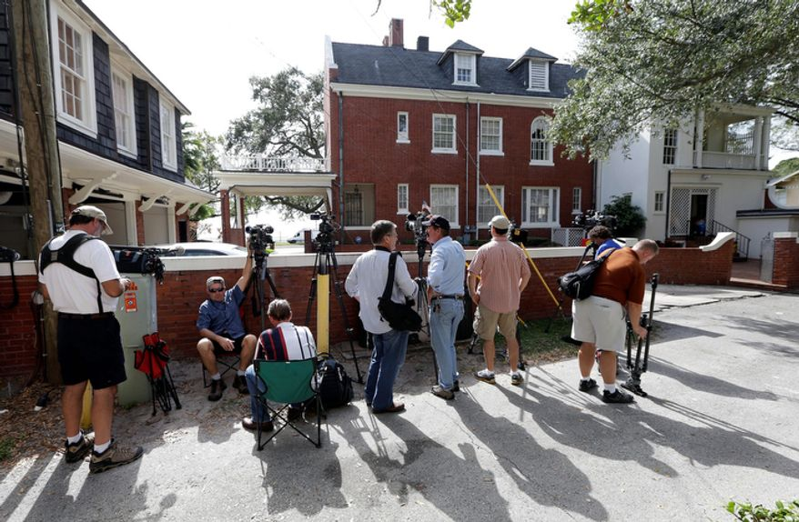 News crews wait behind Jill Kelley's home Tuesday, Nov 12, 2012 in Tampa, Fla. Kelley is identified as the woman who allegedly received harassing emails from Gen. David Petraeus' paramour, Paula Broadwell. She serves as an unpaid social liaison to MacDill Air Force Base in Tampa, where the military's Central Command and Special Operations Command are located. (AP Photo/Chris O'Meara)