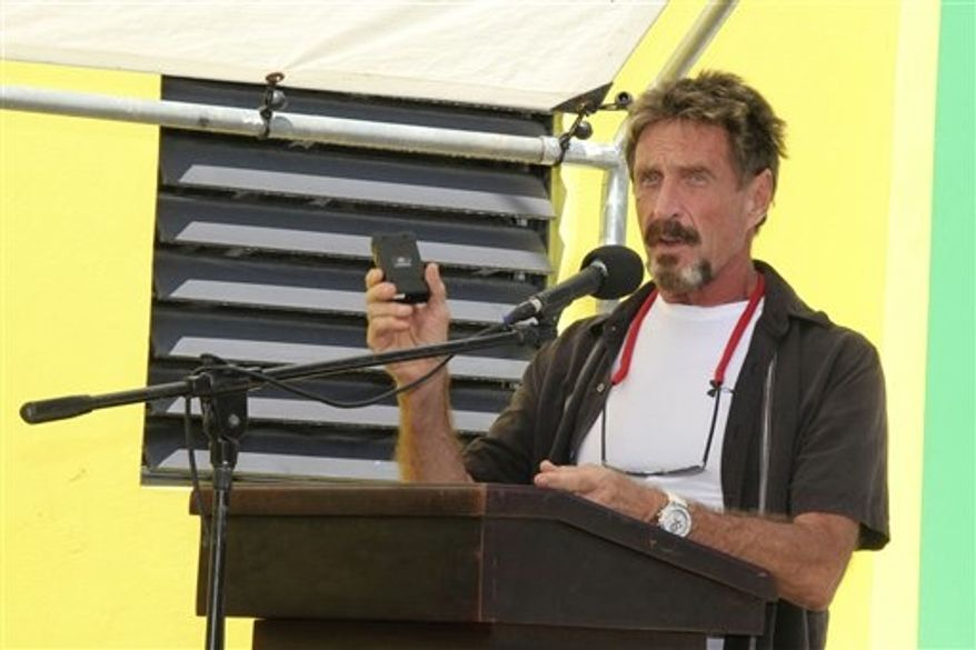 **FILE** Software company founder John McAfee speaks Nov. 8, 2012, at the official presentation of equipment ceremony that took place at the San Pedro Police Station in Ambergris Caye, Belize. (Associated Press/Ambergris Today Online-Sofia Munoz)