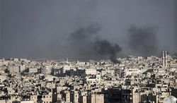 In this Wednesday, Nov. 14, 2012, photo, smoke rises after a Syrian mortar shell landed in a neighborhood in Aleppo, Syria. (AP Photo/Narciso Contreras).