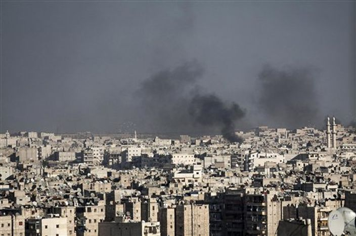In this Wednesday, Nov. 14, 2012, photo, smoke rises after a Syrian mortar shell landed in a neighborhood in Aleppo, Syria. (AP