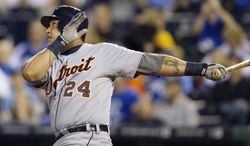 FILE - In this Oct. 3, 2012, file photo, Detroit Tigers' Miguel Cabrera (24) flies out to centerfield during the first inning of a baseball game against the Kansas City Royals at Kauffman Stadium in Kansas City, Mo., Wednesday, Oct. 3, 2012.  Cabrera and Mike Trout are the top contenders for the American League Most Valuable Player award, to be announced Thursday, Nov. 15, 2012.(AP Photo/Orlin Wagner, File)
