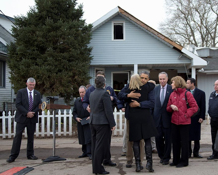 President Barack Obama, accompanied by New York City Mayor Michael Bloomberg, New York Gov. Andrew Cuomo, Homeland Security Secretary Janet Napolitano, Sen. Charles Schumer, D.N.Y., and other, hugs Sen. Kirsten Gillibrand, D-N.Y., after a news conference on Cedar Grove Avenue, a street significantly impacted by Superstorm Sandy, Thursday, Nov. 15, 2012, on Staten Island, in New York. (AP Photo/Carolyn Kaster)